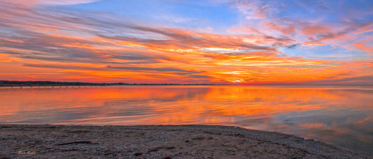 Maria Nesbit Fire in the sky at Copano Bay